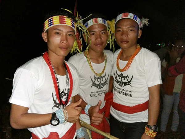 Mentawai boys proudly participating in a cultural festival in Tuapeijat
