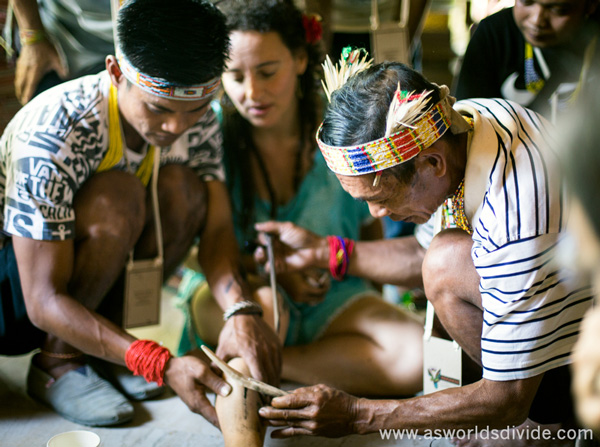 Mentawai 'sipatitik' tattoo artists perform traditional handtapping at the Indigenous Celebration Festival in Ubud, Bali