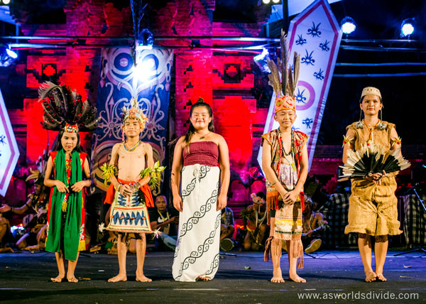Student from the Suku Mentawai Education Foundation's cultural program performs a collaborative dance with children from other cultures at the Indigenous Celebration Festival in Ubud, Bali