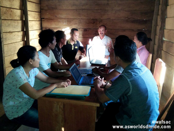 The team at Yayasan Pendidikan Suku Mentawai discuss strategy in Siberut