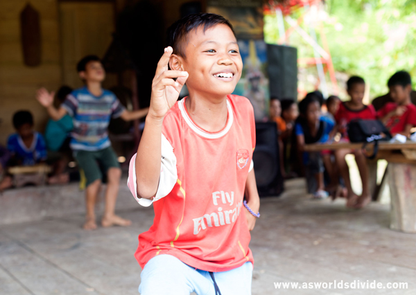 Young Mentawai boy practicing ceremonial dance as part of the Suku Mentawai Education Foundation's cultural education program