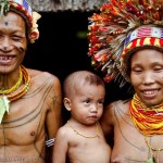 Portrait of a Mentawai shaman, Sikerei, and his family