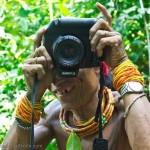 Funny picture of a Mentawai shaman using a digital camera
