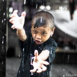 Mentawai boy, Jumer, practicing his kung fu moves in the rain